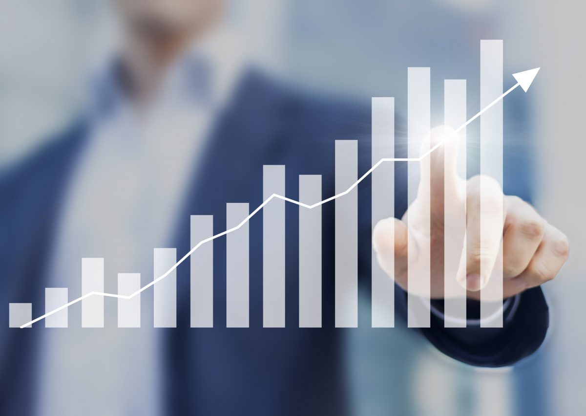 Man pointing to graph chart showing increase over time