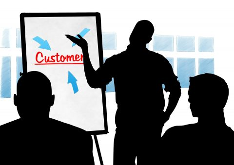 Customer on whiteboard with silhouettes of men