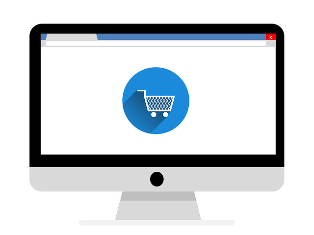 computer monitor with shopping cart in blue icon