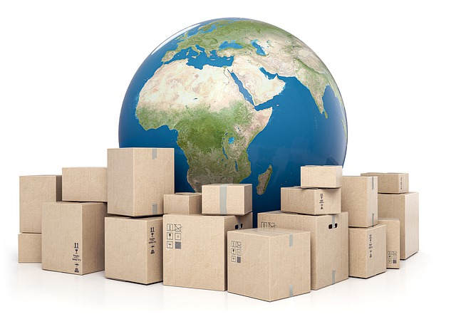 brown shipping boxes in front of the world