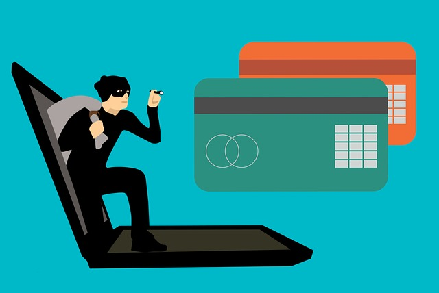animated thief coming out of computer with flashlight shining on credit cards